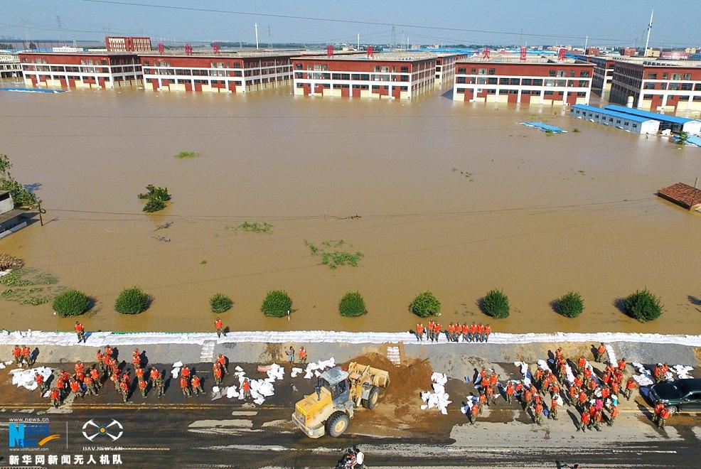 新華網航拍:湖北孝南東山頭107國道洪水得到有效控制