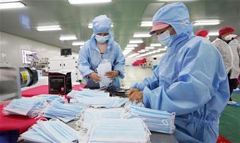 湖北:醫用物資企業全力生産助疫情防控